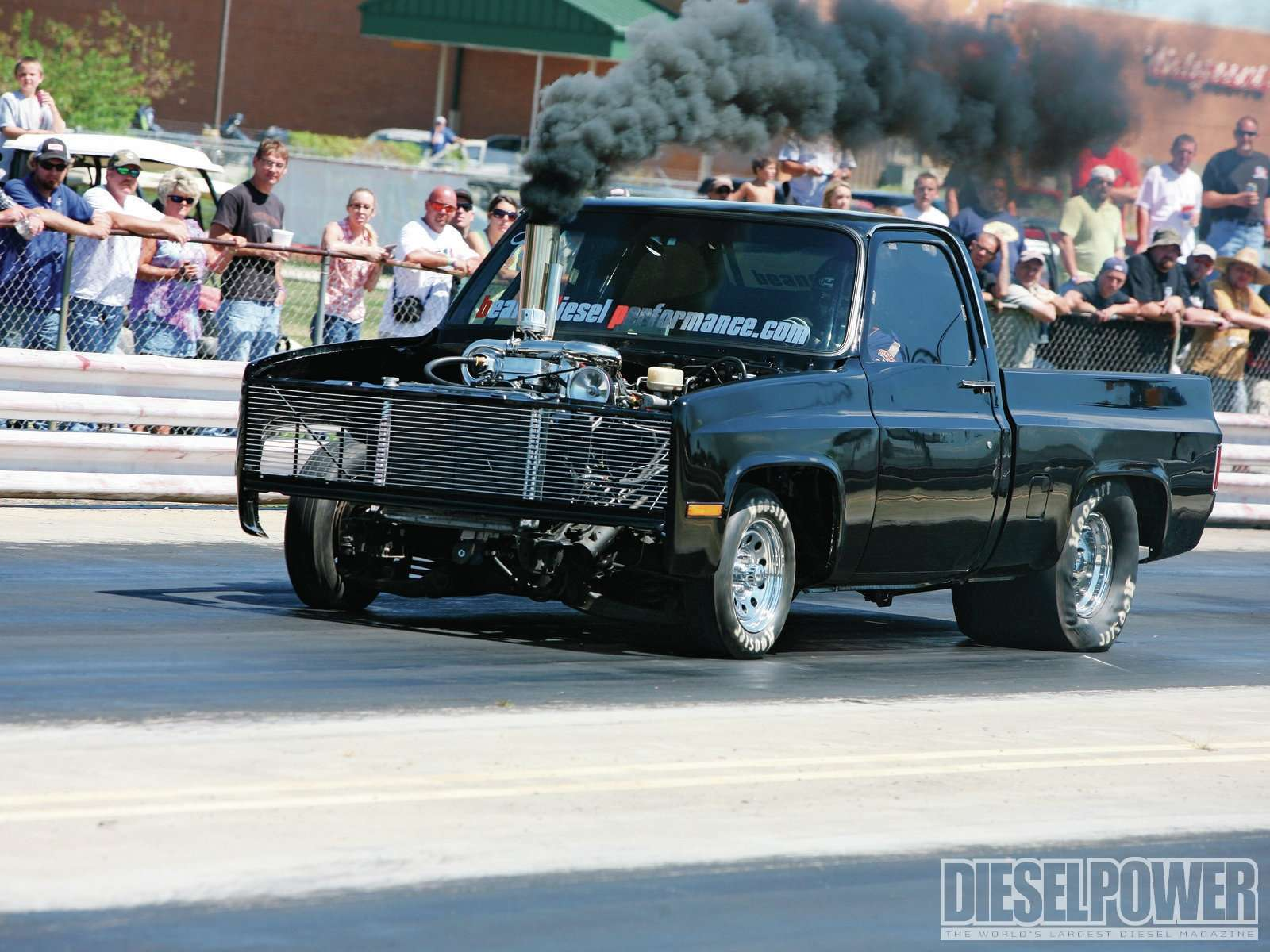 A Wheels Up Chevy Packing Ford Parts And Cummins Power Wallpaper
