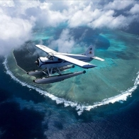 Airplane Over Island Wallpaper