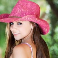 Blue Eyed Girl In Pink Cap Wallpaper