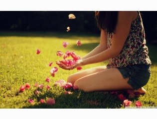 Cute Girl Playing With Flowers