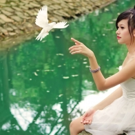 Cute Girl Touching Bird Wallpapers