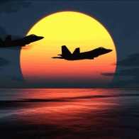 F 22 Raptors Over Sunset Wallpaper