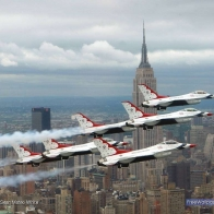 F16 Falcons Above New York City Wallpaper