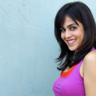 Genelia Dsouza Smiling Side Pose In Purple Top