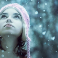 Girl Enjoying Snow Fall