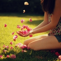 Girl Holding Petals Wallpaper