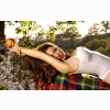 Girl Lying On A Rock Holding A Peach Wallpapers