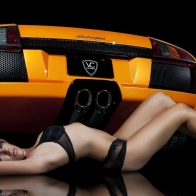 Hot Lady Laying Beside Lamborghini Wallpaper