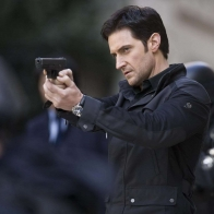 Richard Armitage With Gun Wallpaper