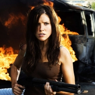 Sophia Bush With Gun Wallpaper
