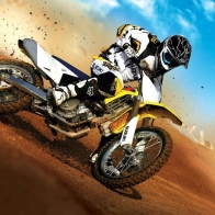 Suzuki Motorcycle Racing On The Sand Wallpaper