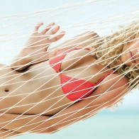 Young Woman Relaxing In A Hammock Wallpaper